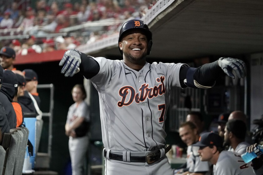 Detroit Tigers' Jonathan Schoop (7) celebrates in the dugout after hitting a solo home run during the third inning of a baseball game against the Cincinnati Reds, Friday, Sept. 3, 2021, in Cincinnati. (AP Photo/Jeff Dean)