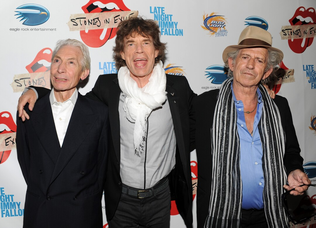 Mick Jagger, center, with his arms around the shoulders of Charlie Watts and Keith Richards.