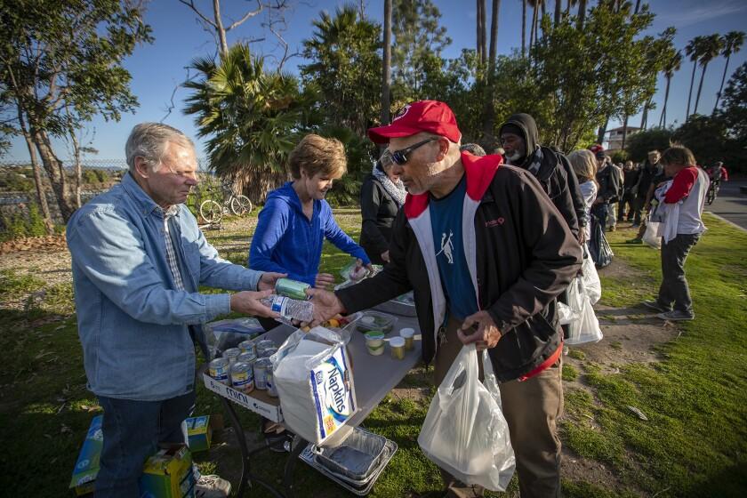DANA POINT, CALIF. -- WEDNESDAY, FEBRUARY 27, 2019: Volunteers from left: Glenn Wood, Jeanne Karcher