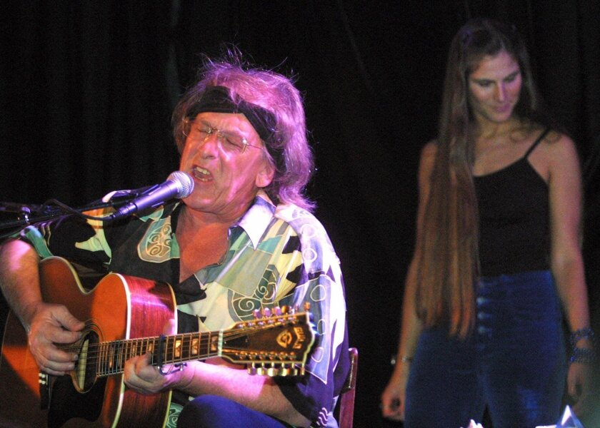 Jefferson Starships' Paul Kantner, left, performs in front of Diana Mangano during the 'Freedom Sings' benefit concert sponsored by the First Amendment Center in New York Weds. June 20, 2001. A portion of proceeds from the concert will benefit the planned Folk Music Musuem in Greenwich Village. (AP Photo/Shawn Baldwin)