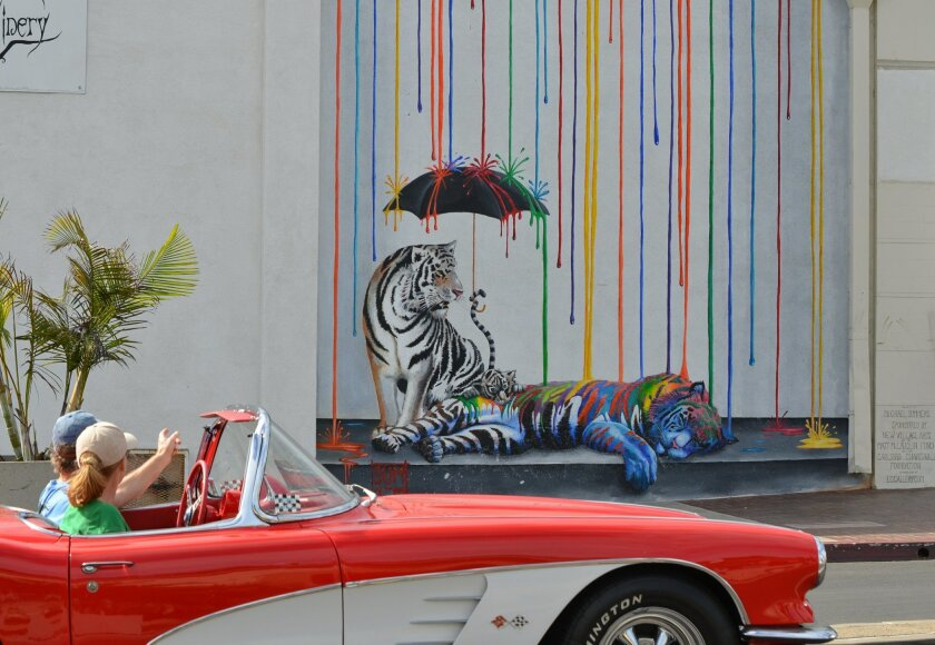 """The Carlsbad Village Association is sponsoring its first Mural Tour taking visitors to see several murals, including """"Catnap"""" by Michael Summers at the corner of Grand Avenue and Carlsbad Boulevard."""