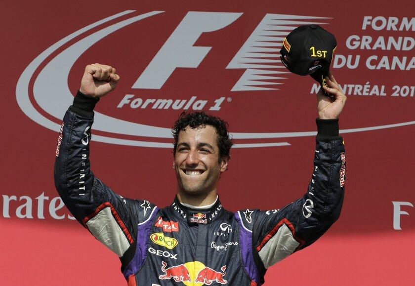 Red Bull driver Daniel Ricciardo, from Australia, celebrates after winning the Canadian Grand Prix Sunday, June 8, 2014, in Montreal. (AP Photo/David J. Phillip)