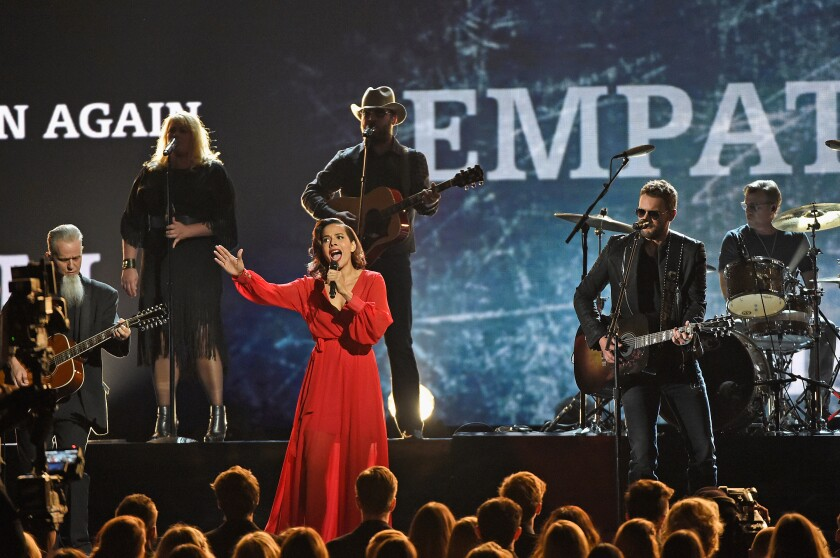 Rhiannon Giddens, Eric Church and other musicians onstage at the 2016 CMA Awards.