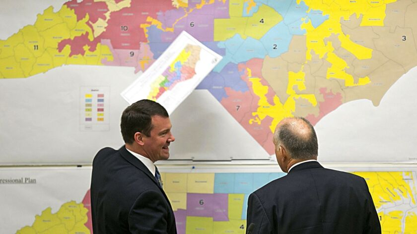 Republican state Sens. Dan Soucek, left, and Brent Jackson review maps as North Carolina's Redistricting Committee meets in Raleigh, N.C., on Feb. 16, 2016.