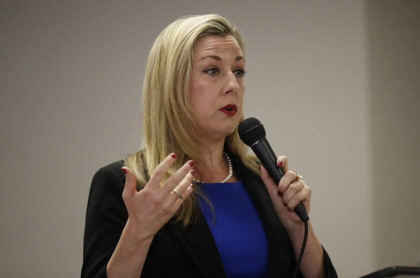 File-This May 10, 2018, file photo shows Kendra Horn speaking during a forum for Oklahoma 5th congressional district seat Democratic candidates for the group Edmond Democratic Women in Edmond, Okla. Nine Republicans are vying for the seat held by first-term U.S. Rep. Horn, the only Democrat in the state's delegation. The 44-year-old attorney pulled one of the nation's biggest congressional upsets in 2018 when she won a seat that had been in Republican hands for four decades. Horn herself also faces a primary opponent in perennial candidate Tom Guild, a retired professor from Edmond. (AP Photo/Sue Ogrocki, File)