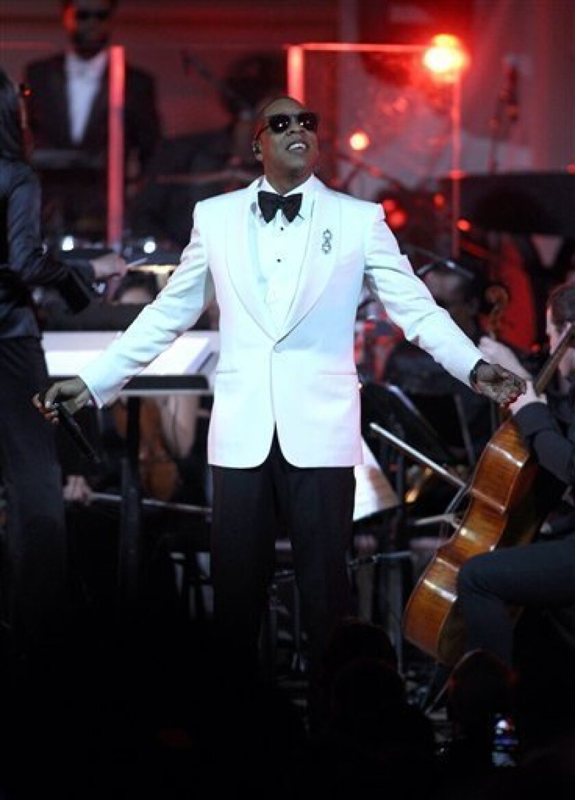 Rapper Shawn Carter, better known as Jay-Z, performs on stage at Carnegie Hall in New York on Monday, Feb. 6, 2012. Ticket sales from the Carnegie Hall shows will benefit the Shawn Carter Scholarship Foundation and the United Way of New York. (AP Photo/Donald Traill)
