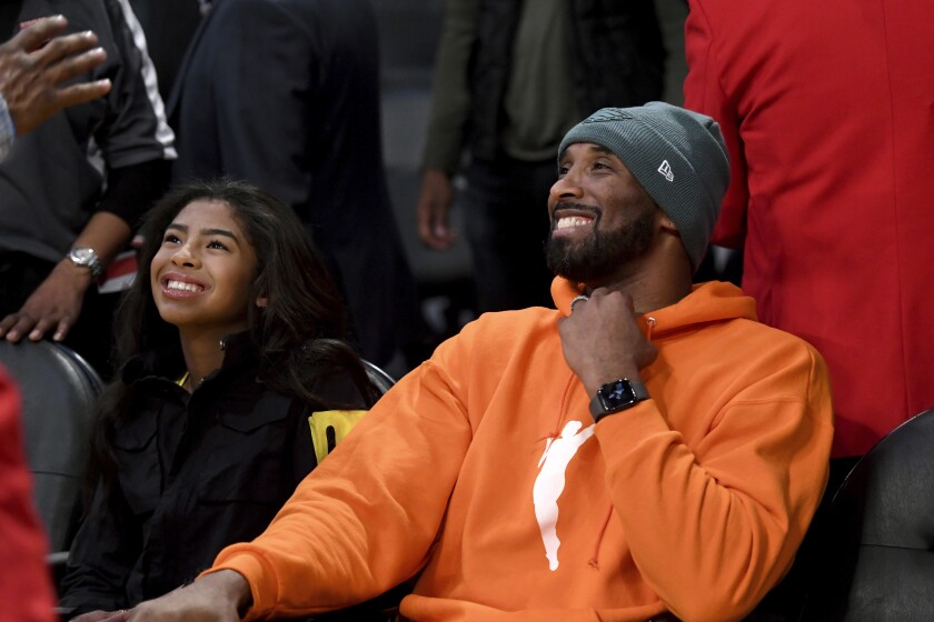 Kobe Bryant and Gianna Bryant on the sidelines at a Lakers-Mavericks game in December.