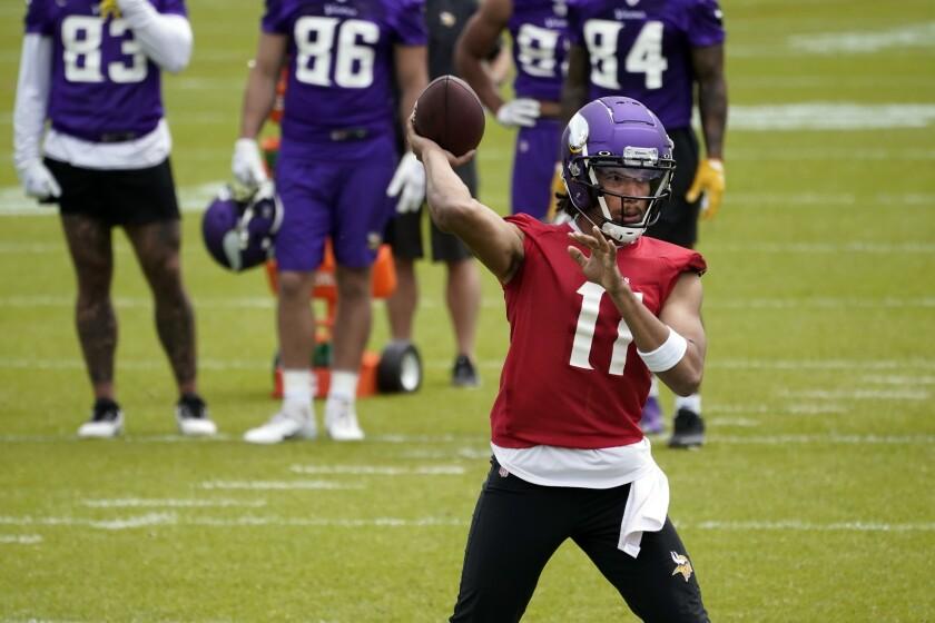 Rookie Minnesota Viking quarterback Kellen Mond throws a pass during NFL football practice in Eagan, Minn., Wednesday, June 2, 2021.(AP Photo/Jim Mone)