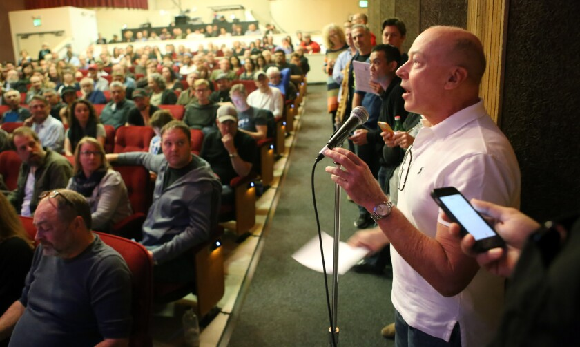 Dan Berkowitz, right, speaks at the town hall meeting on a proposal to raise the minimum wage for 99-seat theaters.
