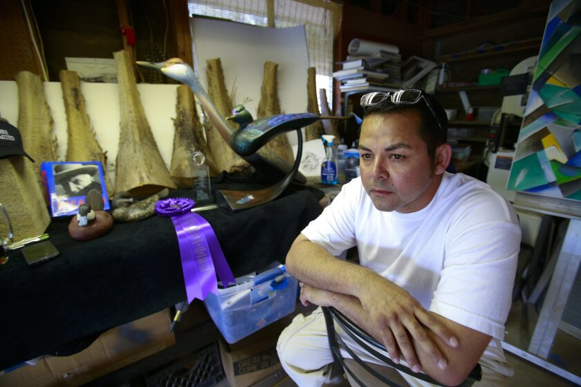SAN DIEGO CA, USA -- MAY 11, 2016: ..Daniel Montano sits in his wood shop at his home where he carves his wooden ducks work of art. Recently Montano was honored with winning the world championship in Interpretive Wood Sculpture in Ocean City, Maryland.......Mandatory Credit: PHOTO BY NELVIN C. CEPEDA, SAN DIEGO UNION-TRIBUNE