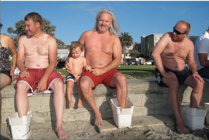 Charles Bower (center) recovers from a stingray sting at La Jolla Shores.