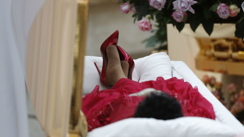 Aretha Franklin lies in her casket at Charles H. Wright Museum of African American History during a
