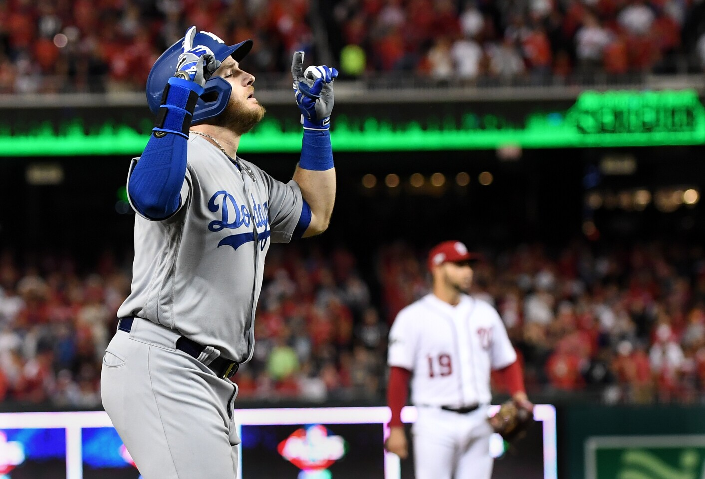 WASHINGTON D.C., OCTOBER 4, 2019-Dodgers Max Muncy celebrates his solo home run in front of Nationals pitcher Anibal Sanchez in the 5th inning in Game 3 of the NLDS at Nationals Stadium Sunday. (Wally Skalij/Los Angeles Times)