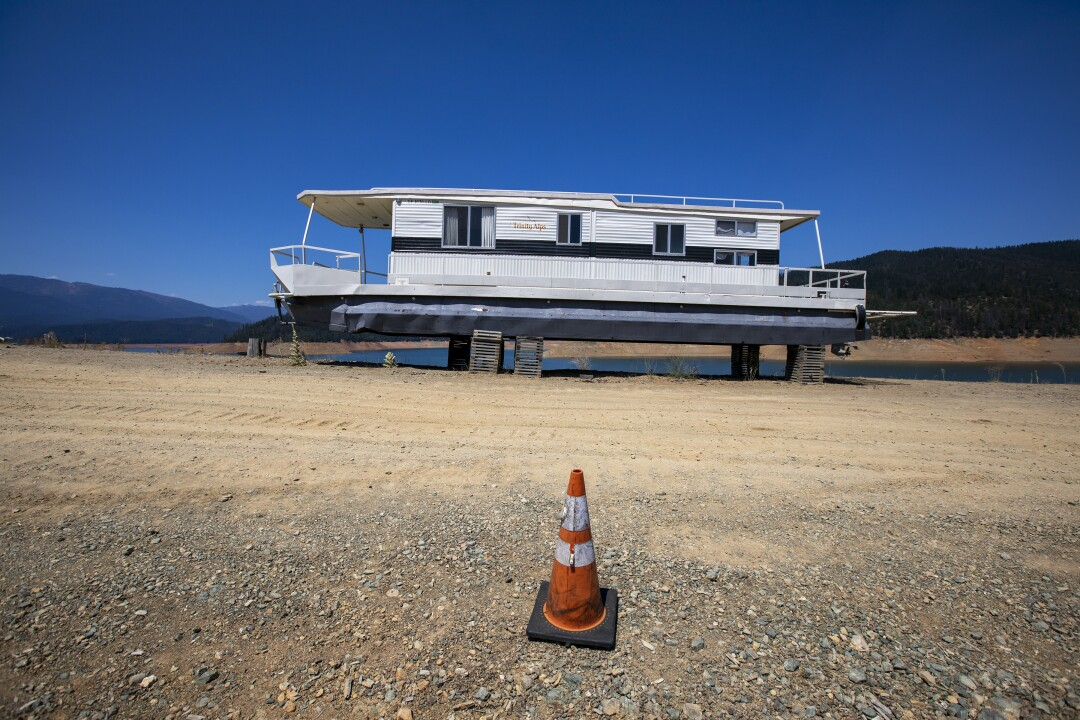 A houseboat is out of the water for repairs at Trinity Lake.