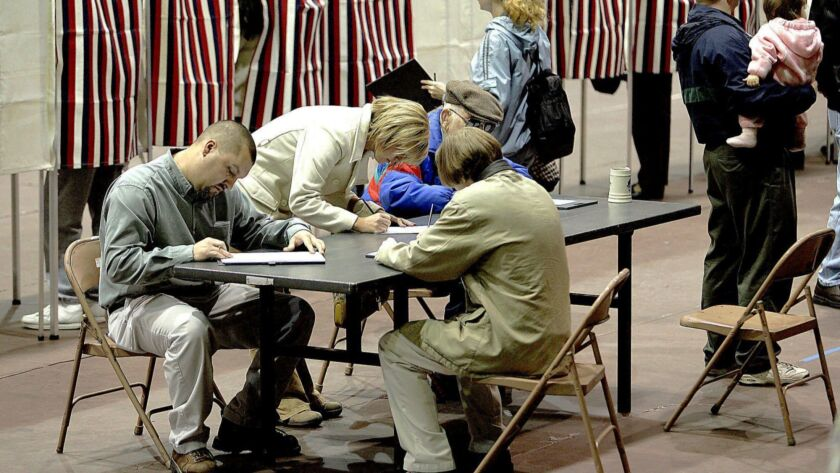 Voters in Dodge City, Kan., cast ballots during the 2004 election.