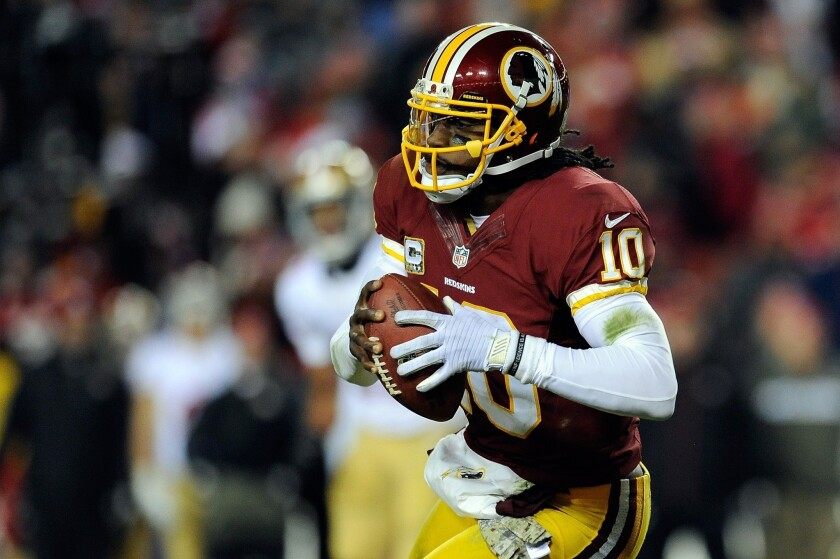 Robert Griffin III has his father's back after locker room visit