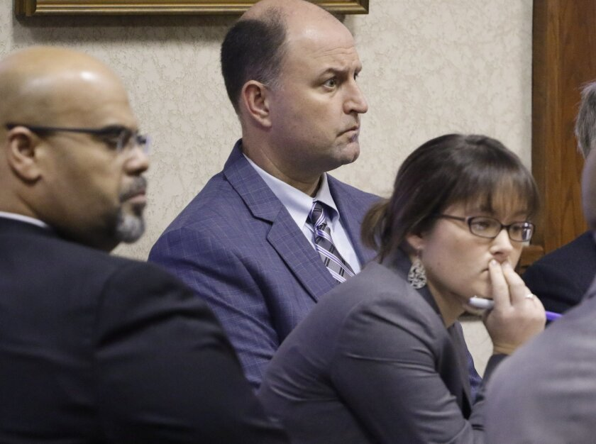 Ooltewah High School Athletic Directer Jesse Nayadley, rear center, appears in Hamilton County Juvenile Court, Thursday, Jan. 21, 2016, in Chattanooga, Tenn. Judge Robert Philyaw denied motions to dismiss charges against Nayadley, and two other high school officials, in facing allegations that they failed to report the sexual abuse of school basketball players by teammates. A preliminary hearing is set for Feb. 15. (Dan Henry/Chattanooga Times Free Press via AP) THE DAILY CITIZEN OUT; NOOGA.COM OUT; CLEVELAND DAILY BANNER OUT; LOCAL INTERNET OUT; MANDATORY CREDIT