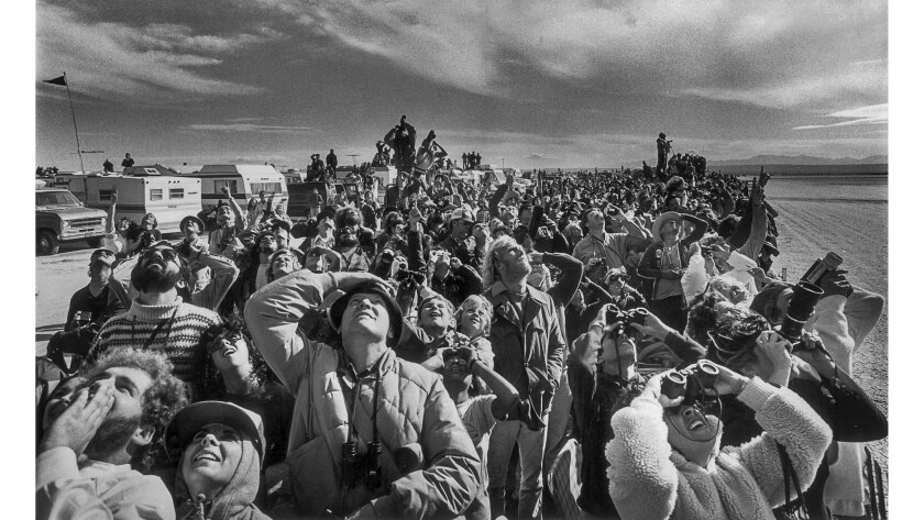 Nov. 14, 1981: Spectators watch the space shuttle Columbia as it lands at Edwards Air Force Base.