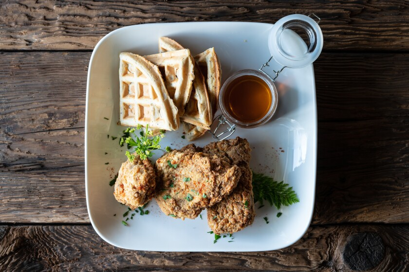 Fried chickën and waffles, made with a vegan alternative to chicken, is one of the items on the menu at newly opened The Plot, a plant-based, zero waste-ethos restaurant in Oceanside.