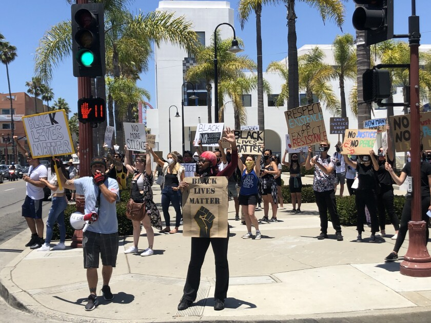 Protesters gathered in Oceanside Sunday morning, carrying Black Lives Matter signs and calling for change.