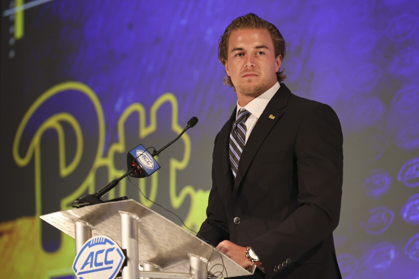 FILE - Pittsburgh quarterback Kenny Pickett listens to a question during an NCAA college football news conference at the Atlantic Coast Conference media days in Charlotte, N.C., in this Wednesday, July 21, 2021, file photo. Pickett returned for a fifth season hoping to help the Panthers become a factor in the ACC's Coastal Division. (AP Photo/Nell Redmond, File)