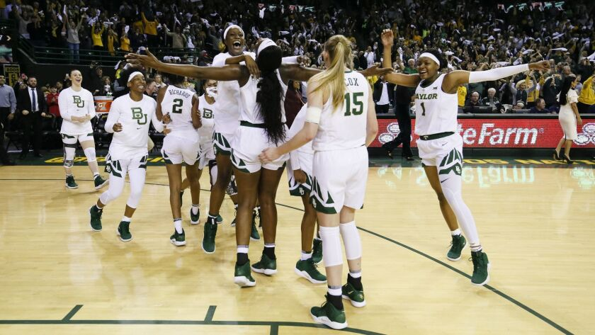 Baylor players celebrate after a 68-57 victory over No. 1 Connecticut in an NCAA college basketball