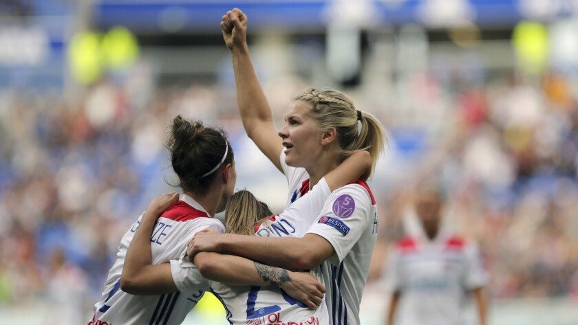 FILE - In this Sunday, April 21, 2019 file photo, Lyon's Delphine Cascarino, center, celebrates with