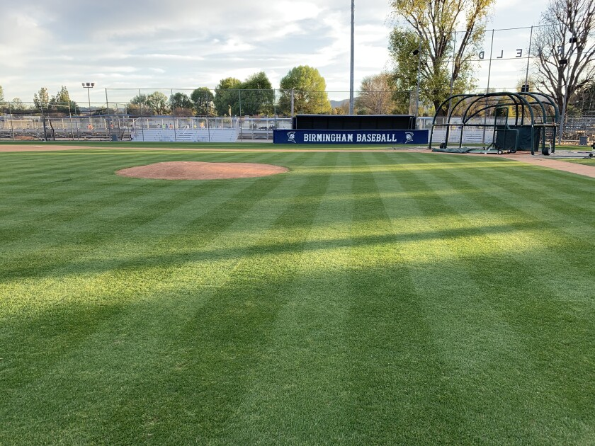 High school baseball coaches go all out to make their baseball fields clean, pristine and perfect.