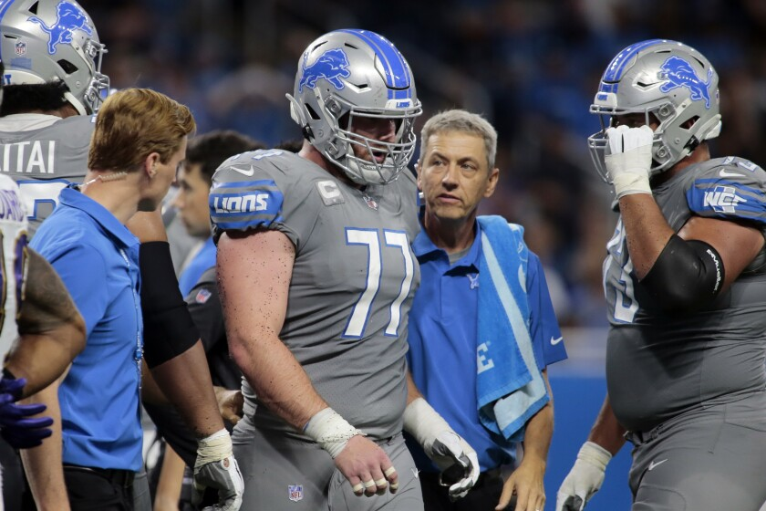 FILE - In this Sunday, Sept. 26, 2021, file photo, Detroit Lions center Frank Ragnow (77) walks to the sidelines after being injured in the second half of an NFL football game against the Baltimore Ravens in Detroit. Ragnow has a season-ending toe injury that requires surgery, a person familiar with the situation told The Associated Press on Tuesday, Oct. 12, 2021. The person spoke on condition of anonymity because the team had not provided an update on Ragnow's condition. (AP Photo/Tony Ding, File)