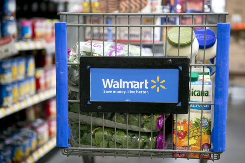 Wal-Mart is spending 500 million Canadian dollars, or $452 million U.S., on expansion efforts there.