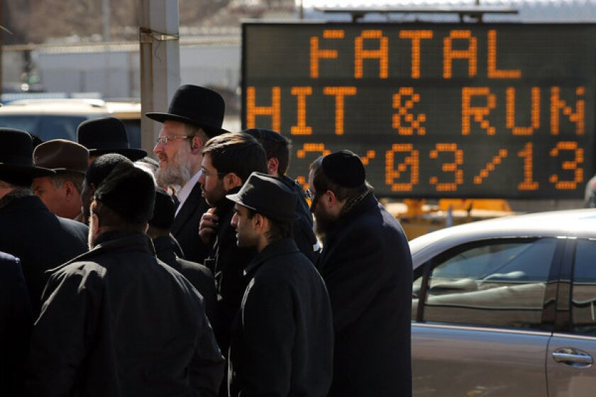 Members of the Brooklyn Orthodox Jewish community attend a news conference Monday to discuss the deaths of an Orthodox couple in a hit-and-run crash, and the death of their baby, prematurely delivered afterward.