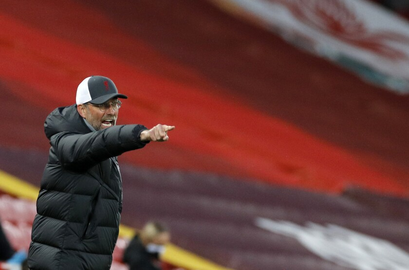 Liverpool's manager Jurgen Klopp reacts during the English Premier League soccer match between Liverpool and Southampton at Anfield stadium in Liverpool, England, Saturday, May 8, 2021. (Phil Noble/Pool via AP)