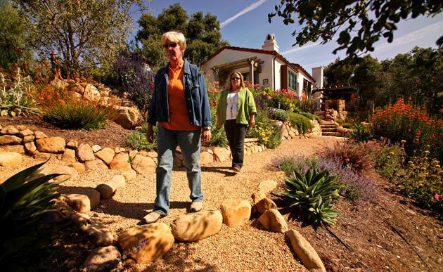 Dawn Close, left, and Margie Grace, principals of Grace Design Associates in Santa Barbara, walk one of the new paths at the Johnsons' home. Grace, who oversees design of the firm's projects, said she wanted to create a garden that reduced future fire threat, required little watering and provided habitat for butterflies, birds and other wildlife.
