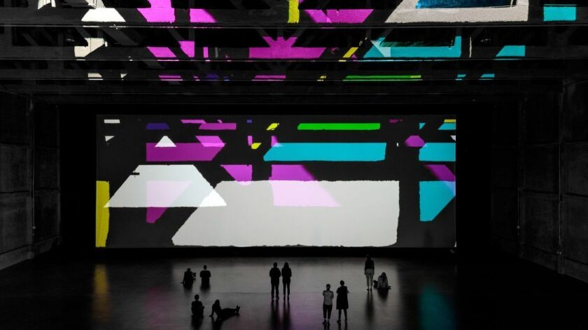 "Olafur Eliasson's kinetic light artwork ""Reality Projector"" shines at the Marciano Art Foundation."