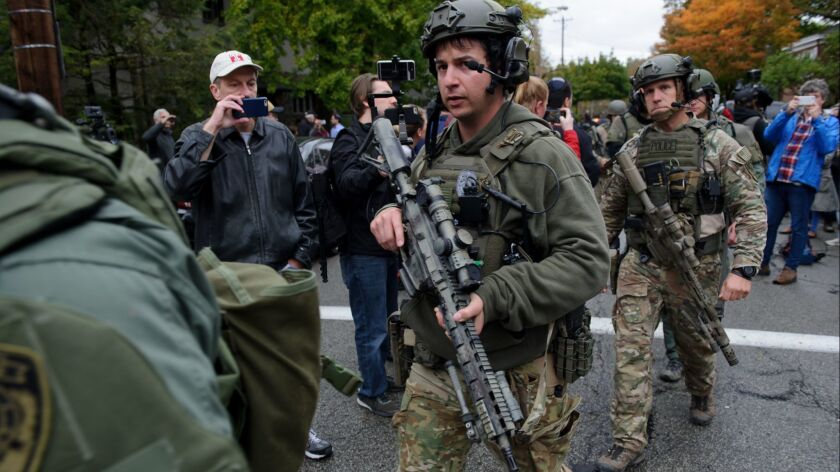 SWAT members leave the scene of a mass shooting at the Tree of Life Synagogue in the Squirrel Hill neighborhood of Pittsburgh on Saturday.