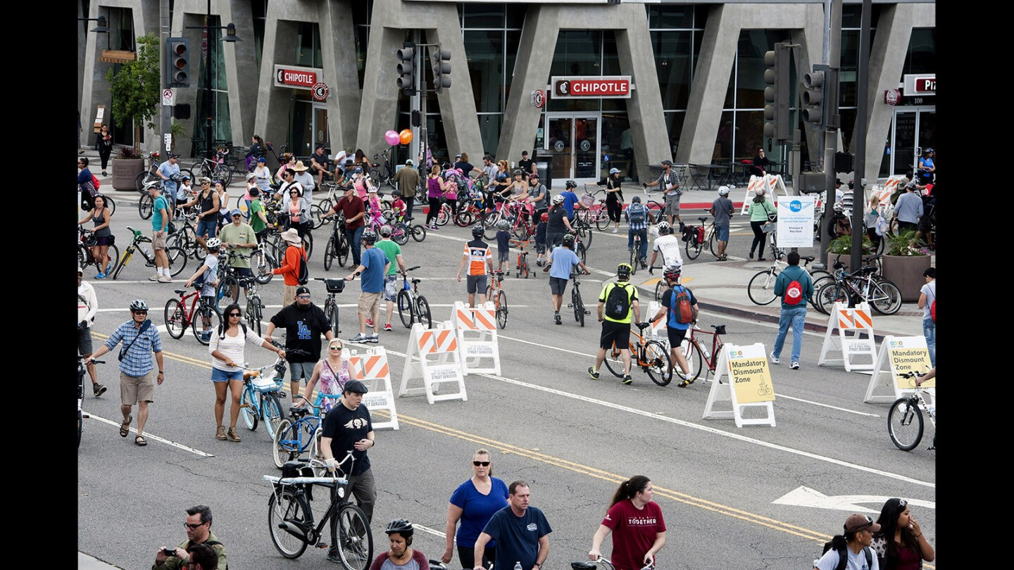 Cyclists ride along the corner of Brand Boulevard and Wilson Avenue during Glendale's first CicLAvia event, which opened its streets to the largest car-free open streets event in America Sunday.