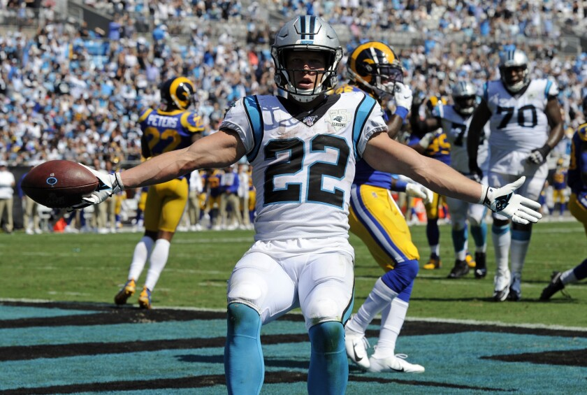 Panthers running back Christian McCaffrey (22) celebrates after scoring a touchdown against the  Rams in Week 1.