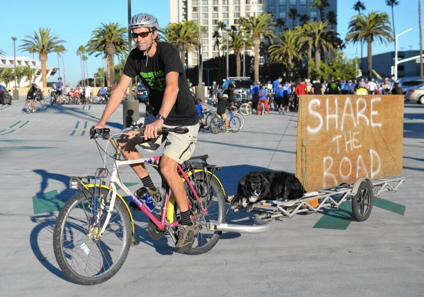 Kurt Bahneman and his dog, Annabelle, prepare for a memorial bike ride in 2012 for two Newport Beach cyclists who were struck and killed by vehicles. Their deaths helped push an effort for bicycle-safety improvements in the city.