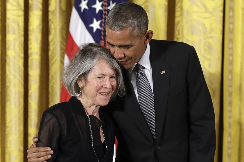 President Obama embraces poet Louise Gluck before awarding her the 2015 National Humanities Medal in September 2016.