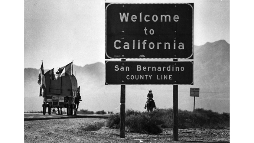 Nov. 30, 1982: A covered wagon crosses into California from Nevada on Interstate 15.