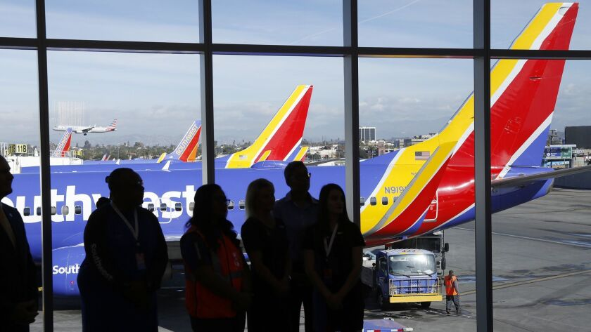 LOS ANGELES, CA - NOVEMBER 30, 2018. Southwest Airlines staff with Southwest planes as a backdrop du