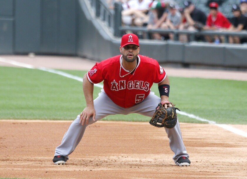 albert pujols angels field baseman earn seven million during through which prefers playing times designated transition hitter expected position he