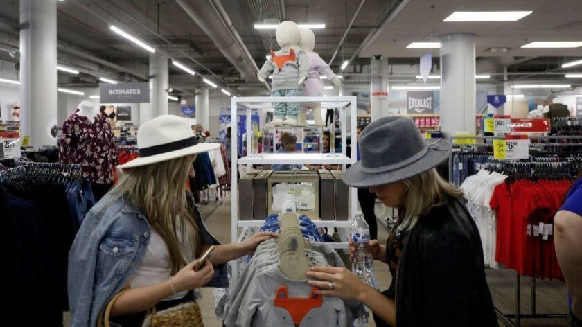Customers browse apparel Oct. 4, 2018, at the recently reopened Sears in Oakbrook Center. The state says the retailer is closing its Niles store and laying off 75 workers there by December.