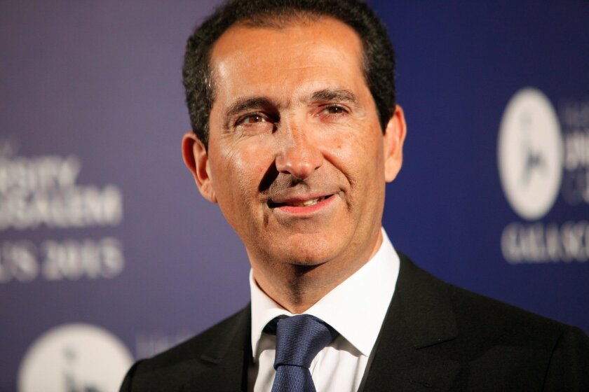 FILE - In this Wednesday, March 18, 2015 file photo, Altice group's Chairman Patrick Drahi poses for photographers at the Scopus Awards of the French Friends of the Hebrew University, in Paris, France. Luxembourg-based Altice SA said Wednesday MAY 20, 2015 it will buy 70 percent of Missouri-based cable TV provider Suddenlink with a combined debt and cash offer from existing owners BC Partners and CPP Investment Board, and company management. (AP Photo/Thibault Camus, File)
