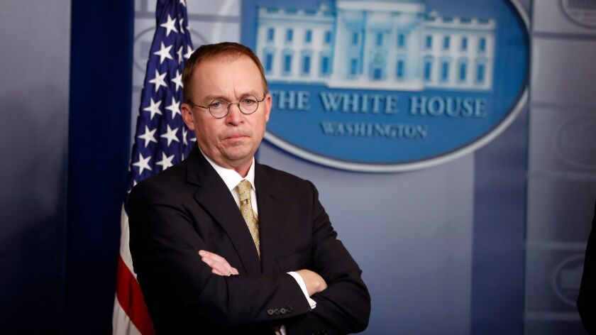 Mick Mulvaney, acting director of the Consumer Financial Protection Bureau, stands during a press briefing at the White House in Washington in January.