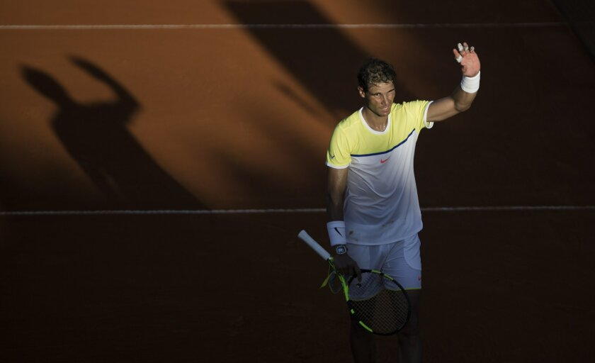 Rafael Nadal of Spain celebrates his victory in a tennis match against Paolo Lorenzi of Argentina at the ATP Argentina Open in Buenos Aires, Argentina Friday, Feb. 12, 2016. (AP Photo/Ivan Fernandez)