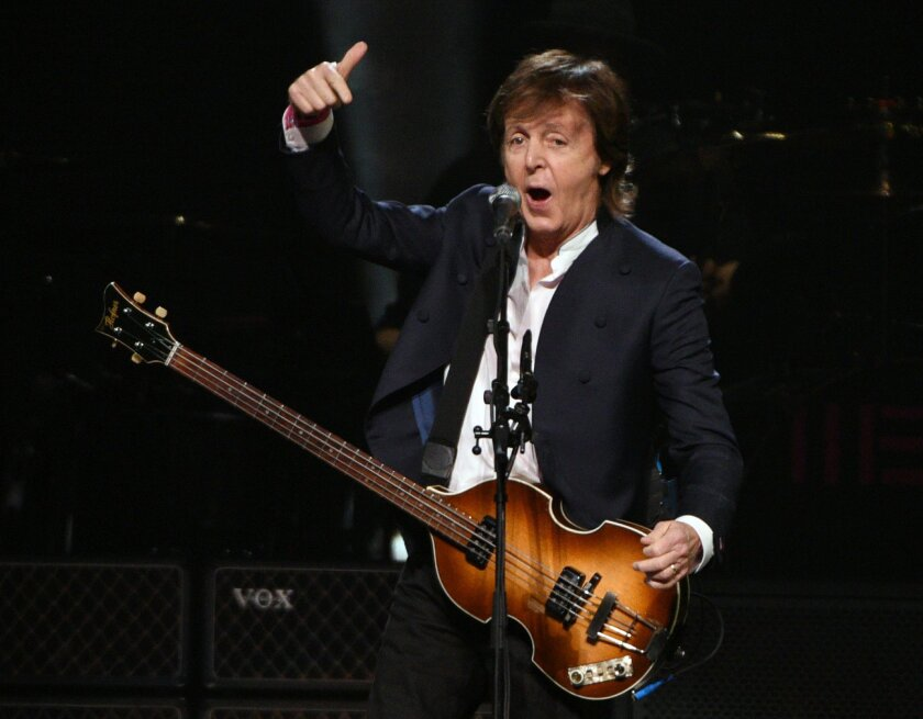 FILE - In this  Oct. 22, 2015, file photo, Paul McCartney performs at First Niagara Center, in Buffalo, N.Y. Goldenvoice announced Tuesday, May 3, 2016, that the Rolling Stones, Bob Dylan, McCartney, Neil Young, Roger Waters and the Who will perform during a three-day concert at the desert grounds
