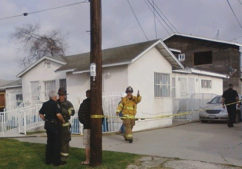 San Diego firefighters and police investigate the cause of a fatal fire.