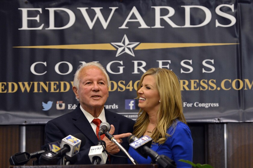 Former Louisiana Gov. Edwin Edwards and his wife, Trina, smiling at a political event in 2014.