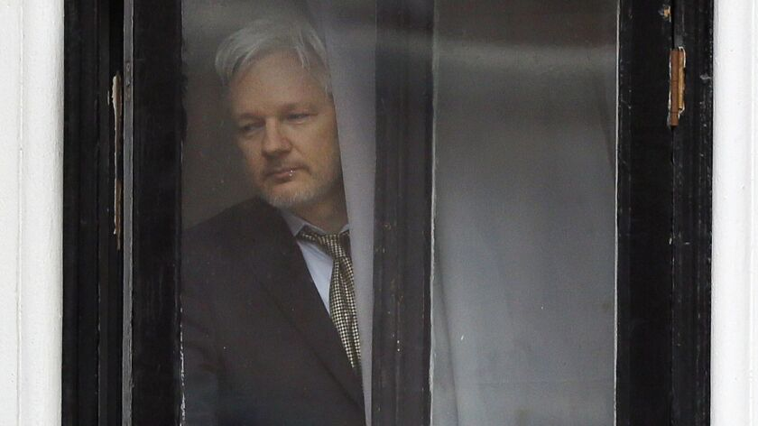 Wikileaks founder Julian Assange walks onto the balcony of the Ecuadorean Embassy in London on Feb. 5, 2016.